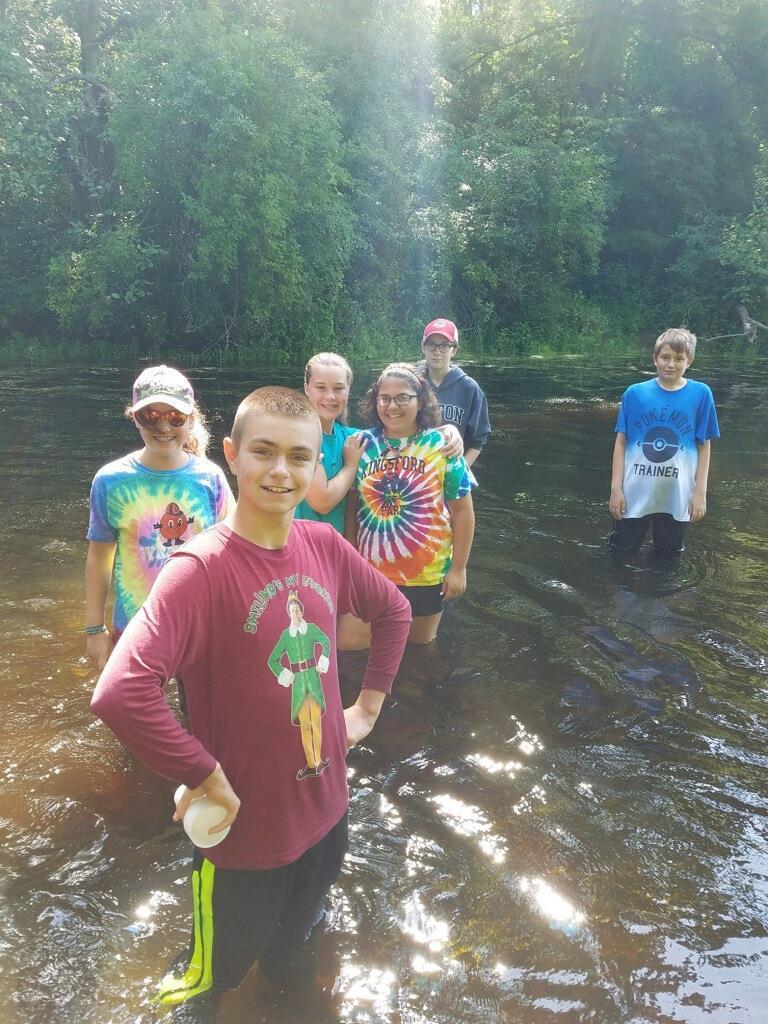 Teens in pond