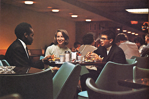1964 yearbook photo of students dining