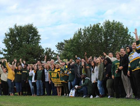 Members of the campus community gather for Green and Gold Day