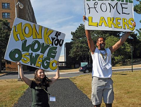 Students holding Oswego signs