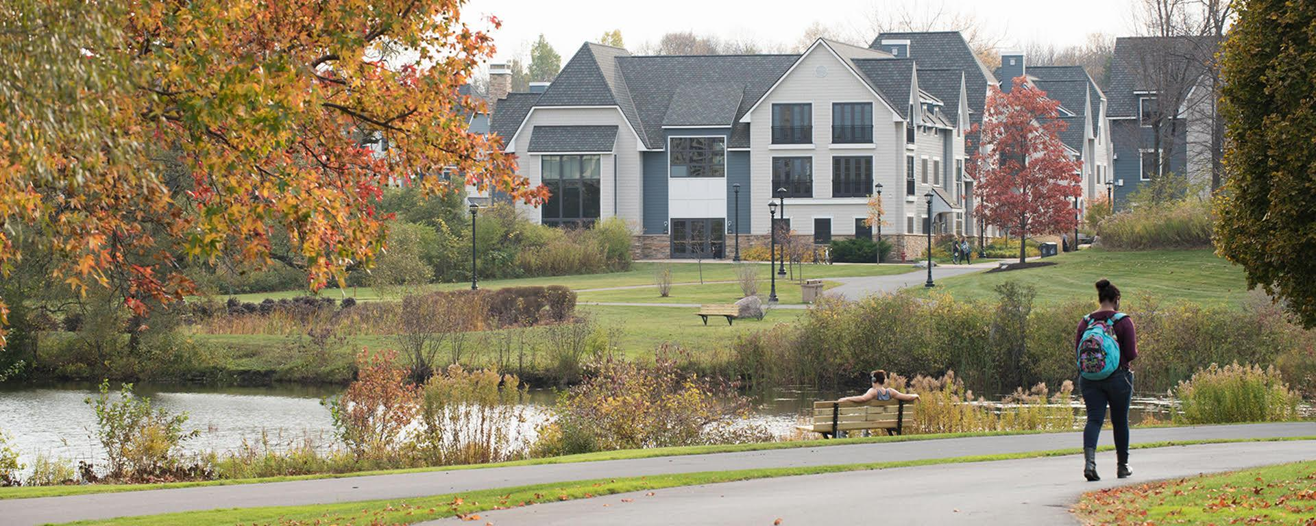 Scene of campus looking across Glimmerglass Lagoon to The Village