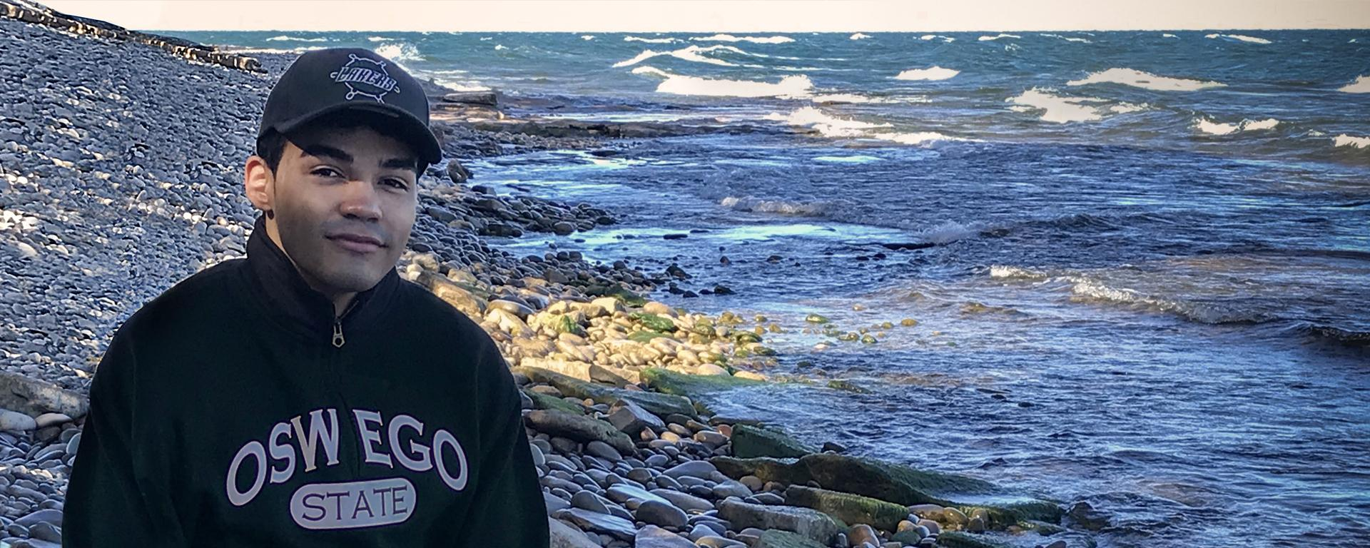 Daniel Garcia stands beside the waters of Lake Ontario