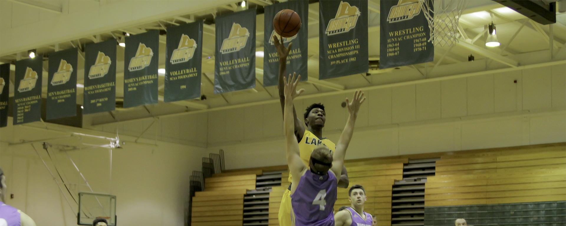 Tyler Pierre rises to shoot the basketball