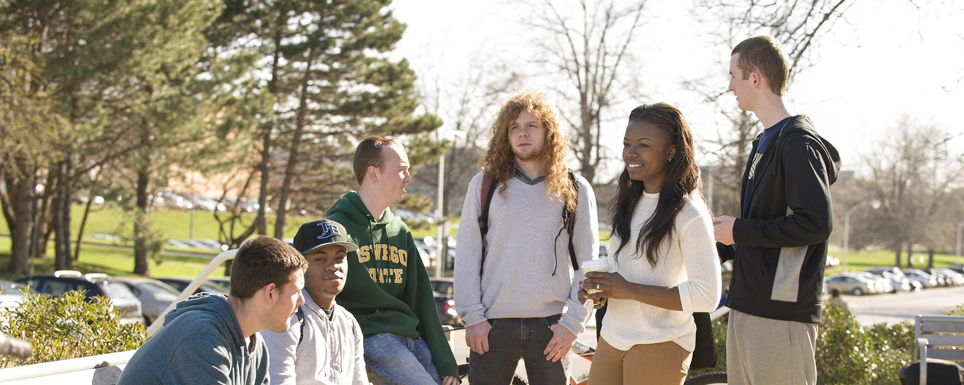 Students sitting in a group outside on campus
