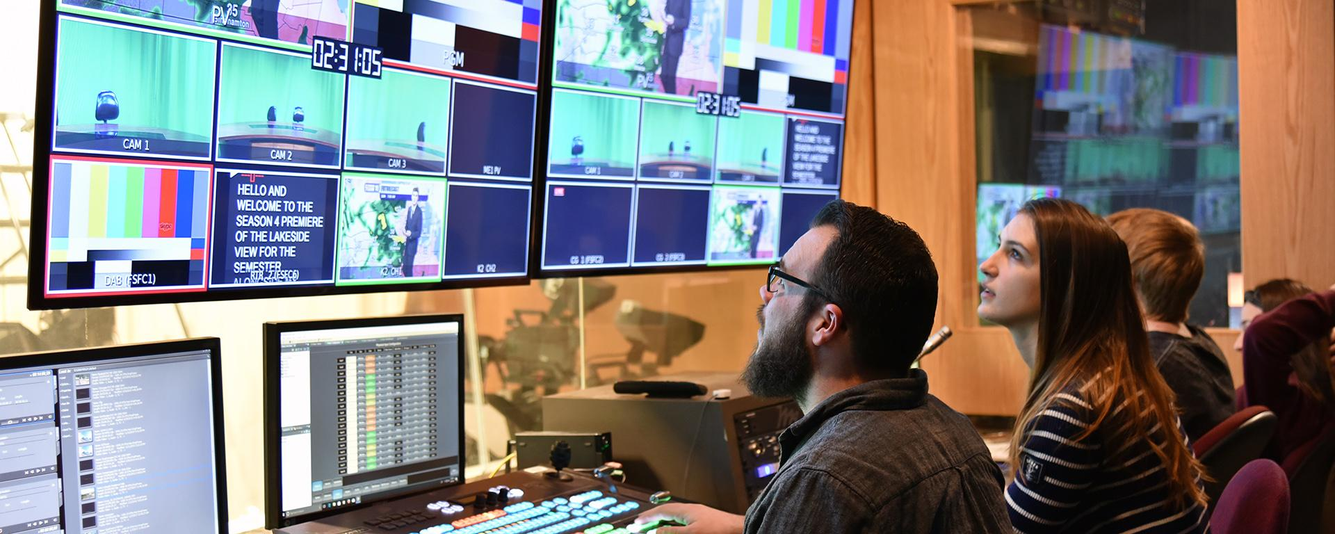 Students work in an advanced TV studio
