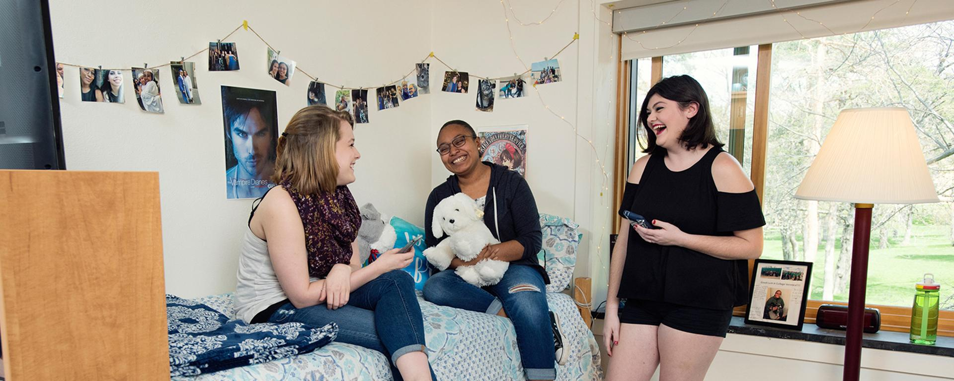 Students enjoying a bright residence hall