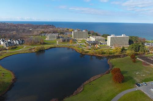 Aerial view of Oswego campus and Lake Ontario