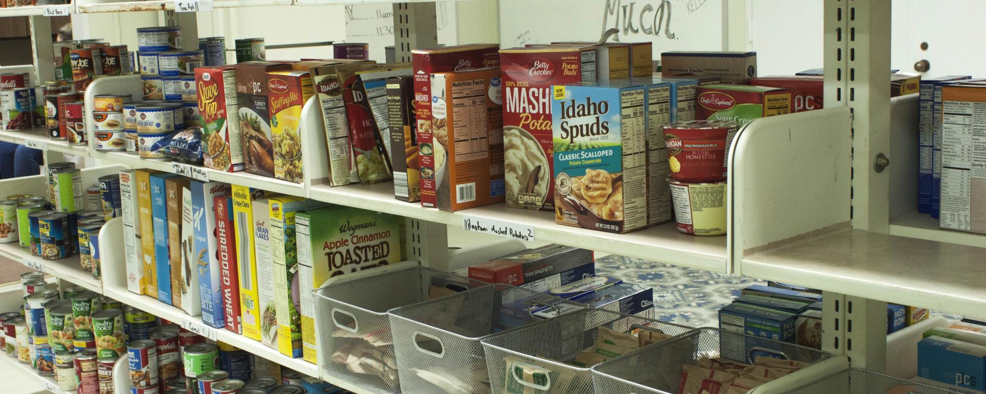 Image of shelf with various canned food items