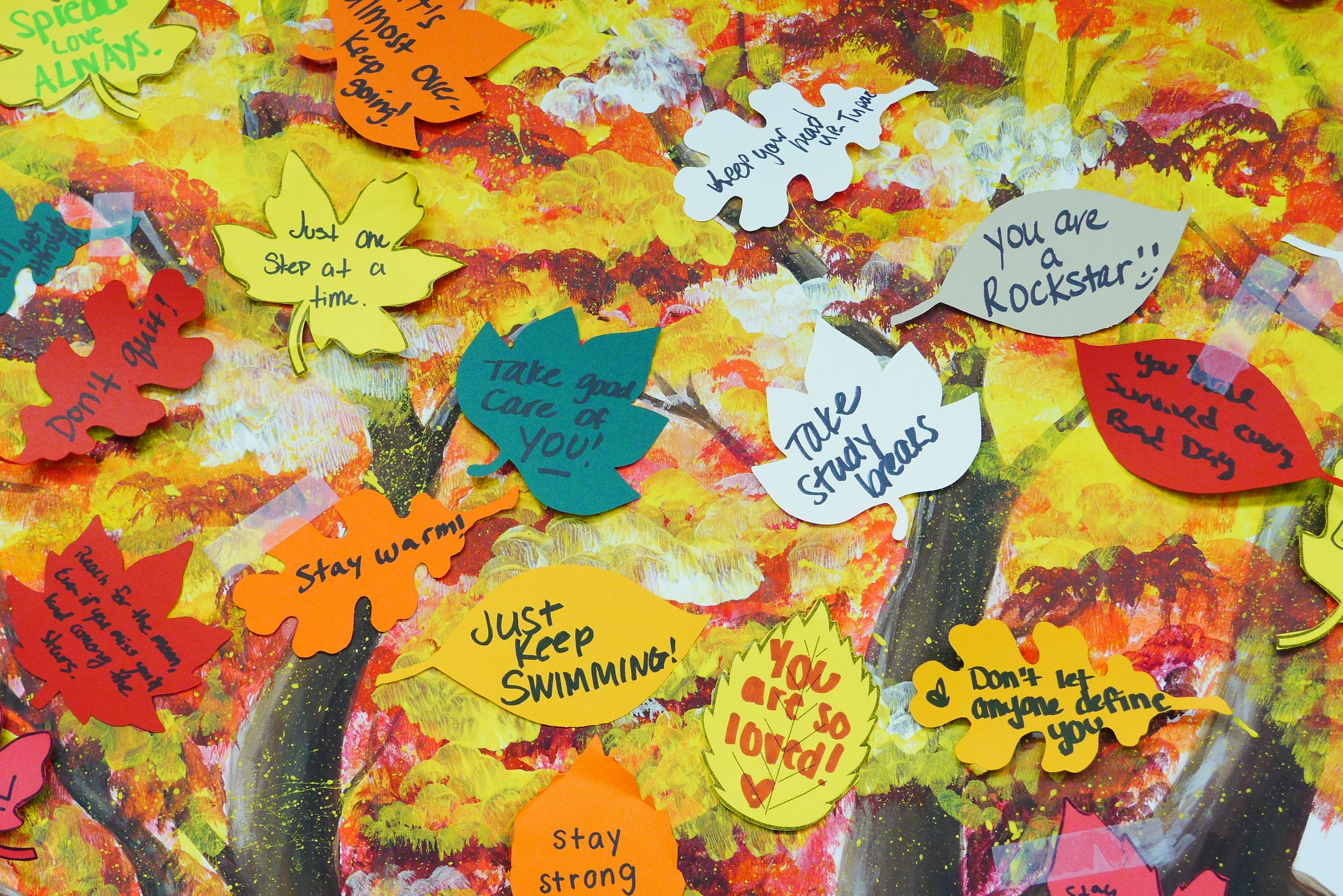 Painting of a positivity tree. The tree has leafs that students can write positive quotes on to attach to the tree.