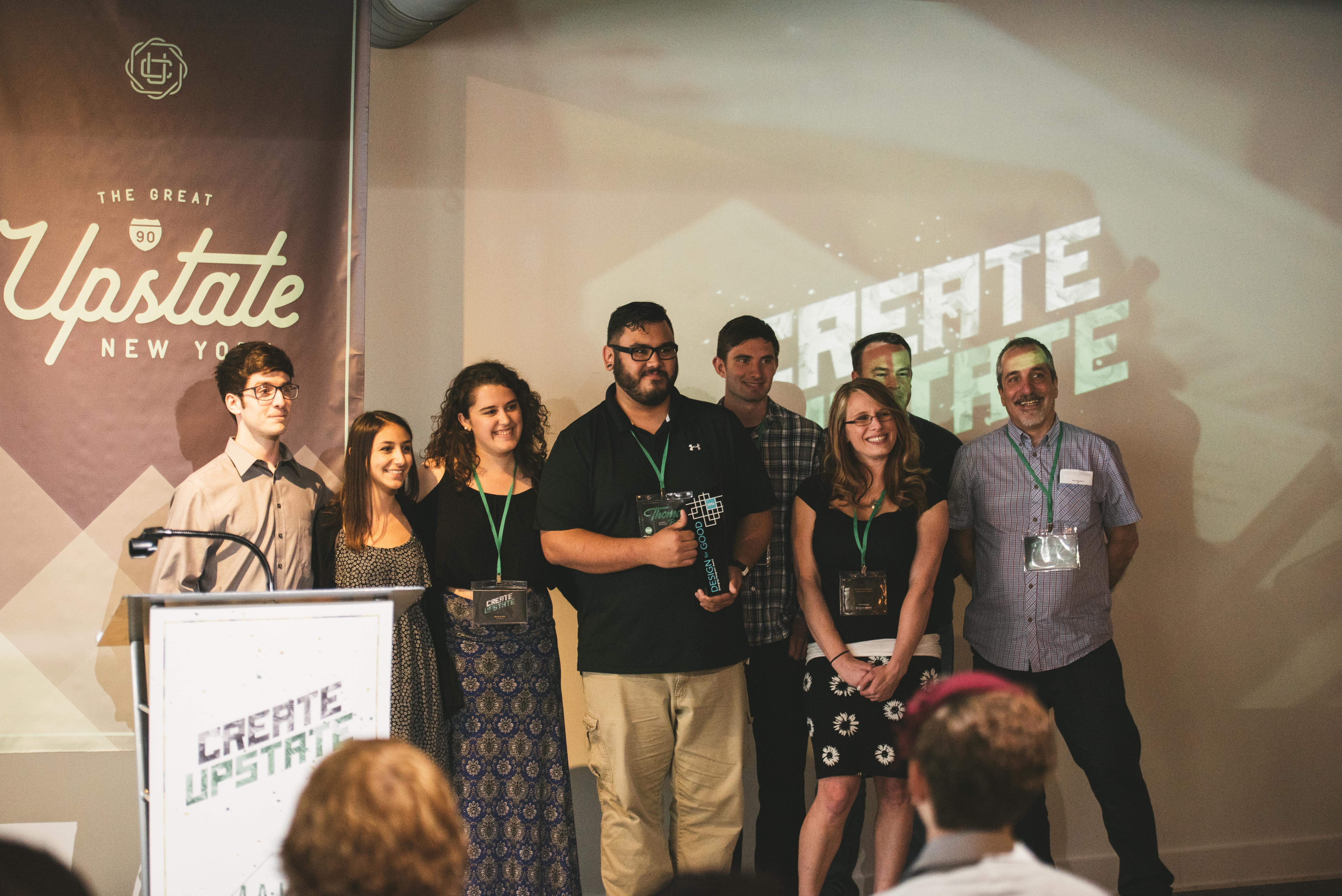 Photo of the team accepting the AIGA Upstate Emerging Designers' Award. Photo courtesy of Tom Studios.